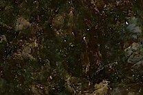 A medium grained, dark green granite with some lighter specks.