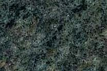 A fine grained, green and grey granite.