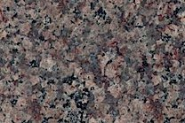 A pink and brown granite with blue, violet and red specks.